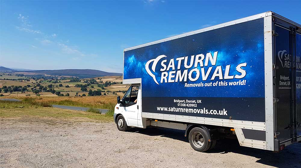 Saturn Removals van in the countryside