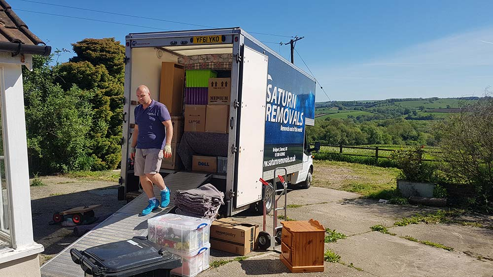 Saturn Removals unloading a residential move in rural Dorset